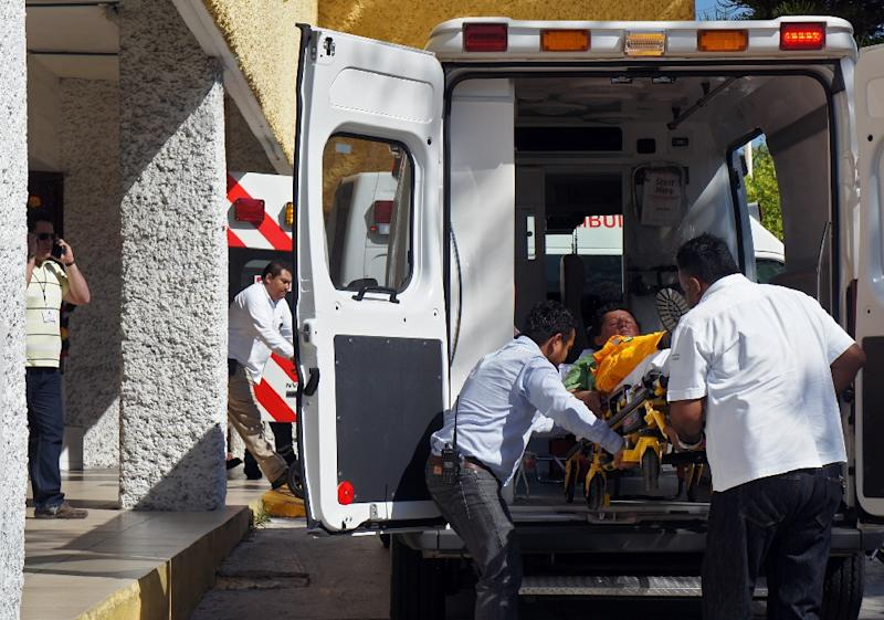 A wounded worker arrives at a hospital after being evacuated from the Abkatun A-Permanente platform on the Gulf of Mexico's Campeche Sound on April 1, 2015