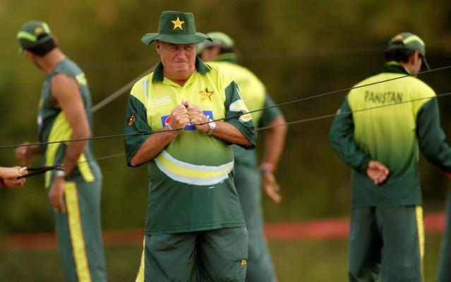 FILE PHOTO: Pakistan's coach Bob Woolmer attends his team's training session near Port of Spain