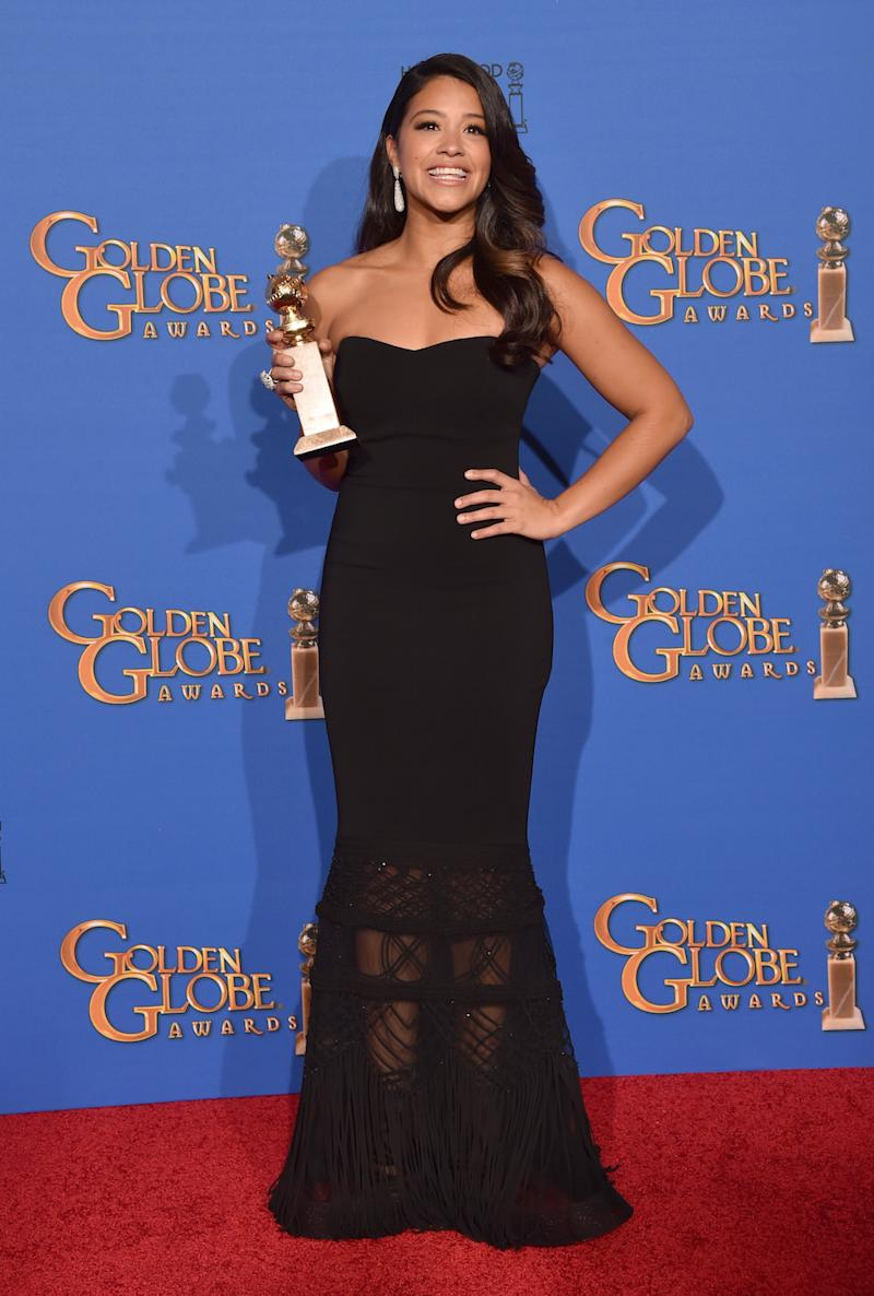 Gina Rodriguez in Badgley Mischka at the 2015 Golden Globes. She eventually lent the dress to a fan for her prom. (Photo: Getty Images)