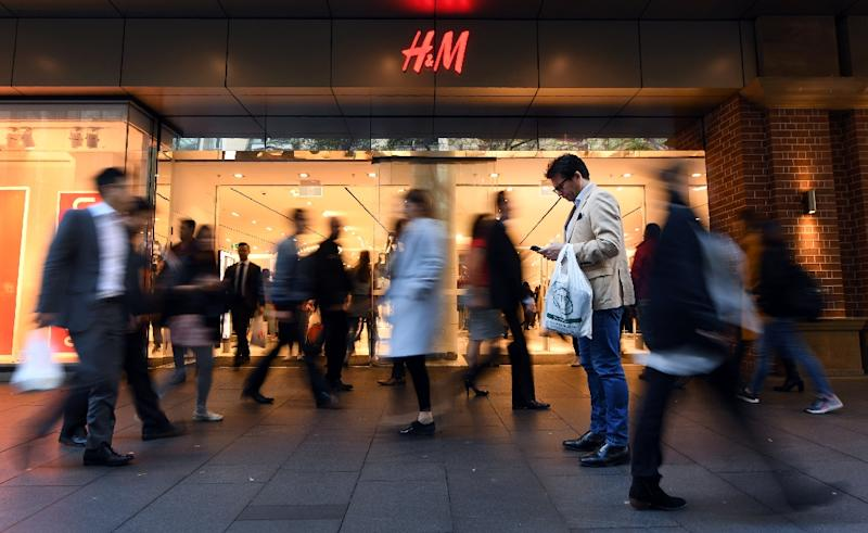 """""""Shopping centres are the modern village, it's where everyone comes together"""" (AFP Photo/WILLIAM WEST)"""