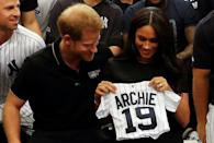 """<p>She's rooting for #19! The Duke and Duchess of Sussex looked touch to receive a custom gift from the New York Yankees a month after their son was born, smiling with a custom jersey stitched with his name and """"19"""" – a nod to the year he was born.</p>"""