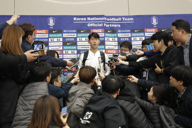 "South Korean national soccer team player Son Heung-min answers a reporter's question upon his arrival at Incheon International Airport in Incheon, South Korea, Thursday, Oct. 17, 2019. South Korea's national soccer team has described their World Cup qualifier against North Korea in Pyongyang as a ""rough"" and strange match. (AP Photo/Lee Jin-man)"