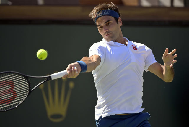 Roger Federer, of Switzerland, returns a shot to Hubert Hurkacz, of Poland, at the BNP Paribas Open tennis tournament Friday, March 15, 2019, in Indian Wells, Calif. Federer won 6-4, 6-4. (AP Photo/Mark J. Terrill)