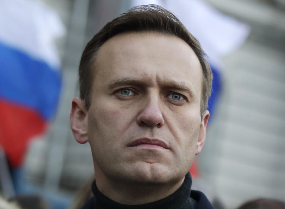 Russian opposition activist Alexei Navalny takes part in a march in memory of opposition leader Boris Nemtsov in Moscow, Russia, Saturday, Feb. 29, 2020. Thousands of people marched on a central Moscow boulevard Saturday in remembrance of a Russian opposition leader who was gunned down five years ago while walking on a bridge adjacent to the Kremlin. (AP Photo/Pavel Golovkin)