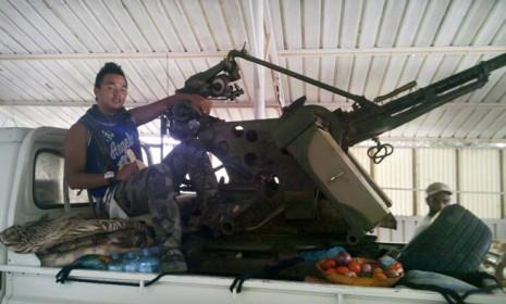 Chris Jeon mans an anti-aircraft weapon in Ras Lanuf, Libya.