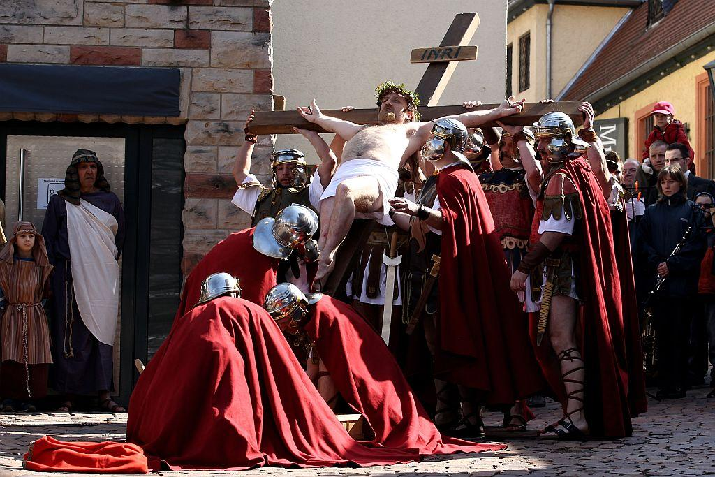 Actors take part in a re-enactment of the crucifixion of Jesus by the Romans on Good Friday 2010 in Bensheim, Germany.