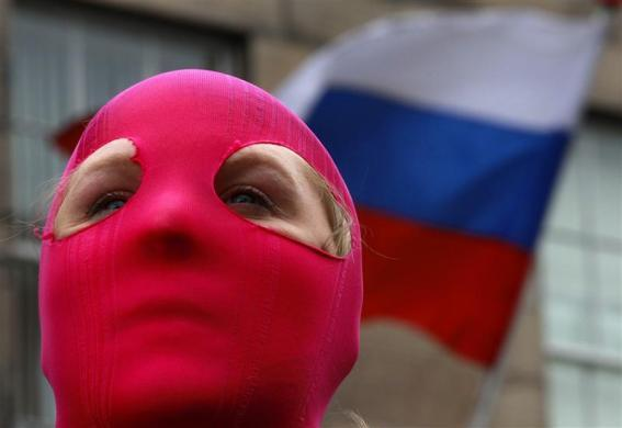 A protestor stands outside the Russian Consulate General building during a demonstration of support for the female Russian female punk band Pussy Riot in Edinburgh, Scotland August 17, 2012.