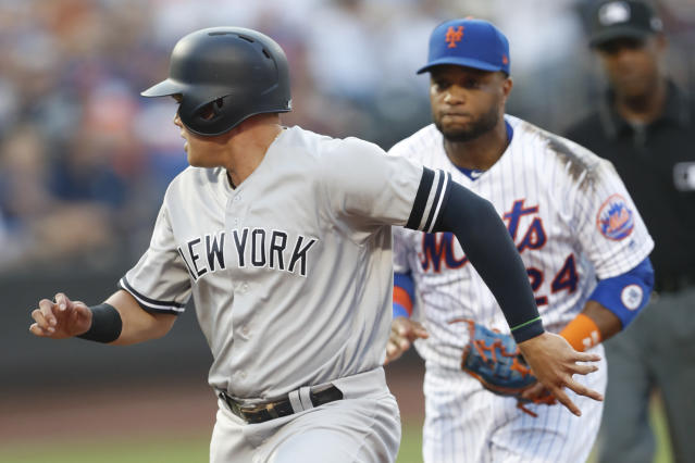 New York Mets second baseman Robinson Cano chases New York Yankees' Gio Urshela who got caught in a rundown between first and second on a grounder to first by Brett Gardner, who was put out at first to start the double play during the second inning of a baseball game Wednesday, July 3, 2019, in New York. (AP Photo/Kathy Willens)