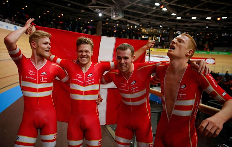 Denmarks Lasse Norman Hansen Denmarks Julius Johansen Denmarks Frederik Rodenberg Madsen and Denmarks Rasmus Pedersen celebrate Gold and a new World Record in the mens Team Pursuit Finals at the UCI track cycling World Championship at the velodrome in Berlin on February 27 2020 Photo by Odd ANDERSEN AFP Photo by ODD ANDERSENAFP via Getty Images