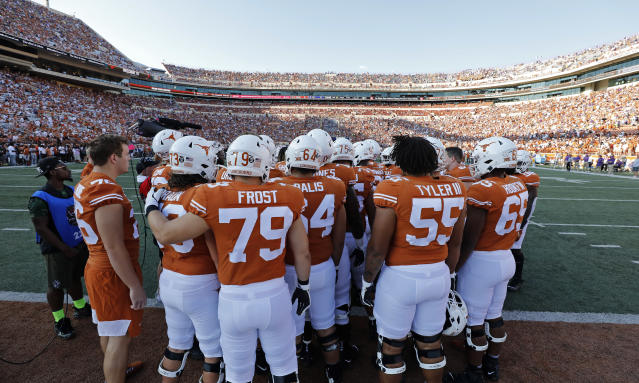 Members of the Texas Longhorns football team huddle before the game against the LSU Tigers, Saturday Sept. 7, 2019 at Darrell K Royal-Texas Memorial Stadium in Austin, Tx. ( Photo by Edward A. Ornelas )