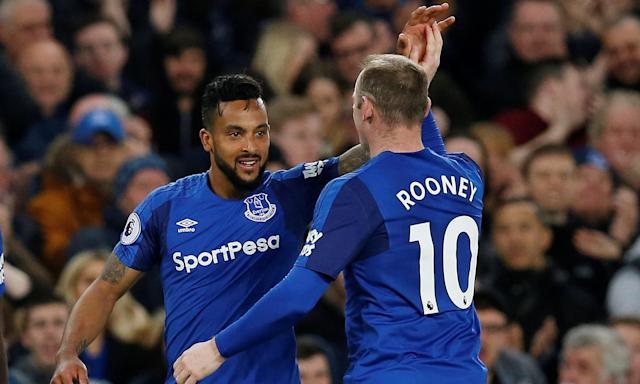 Theo Walcott is congratulated by Wayne Rooney after scoring for Everton against Newcastle at Goodison Park.