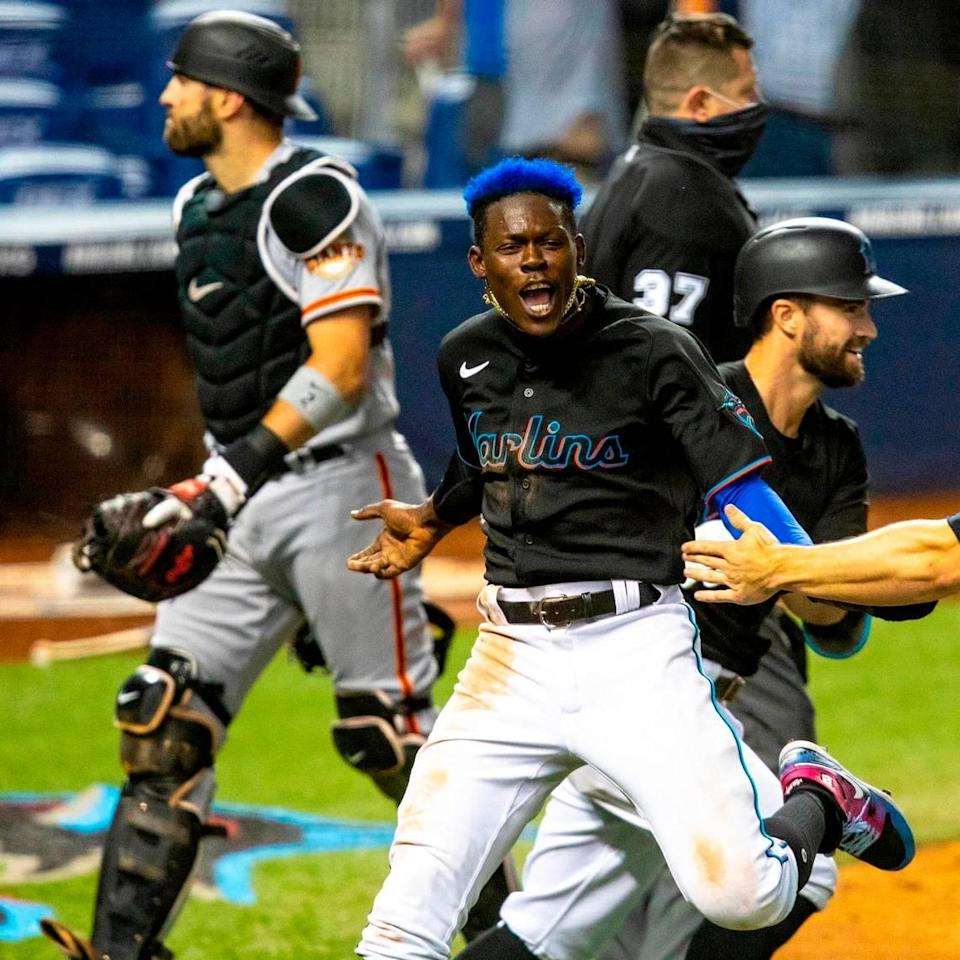 Miami Marlins infielder Jazz Chisholm Jr.†(2) reacts after scoring off a Jorge Alfaro (38) double in the tenth inning of an MLB game against the San Francisco Giants at loanDepot park in the Little Havana neighborhood of Miami, Florida, on Saturday, April 17, 2021.