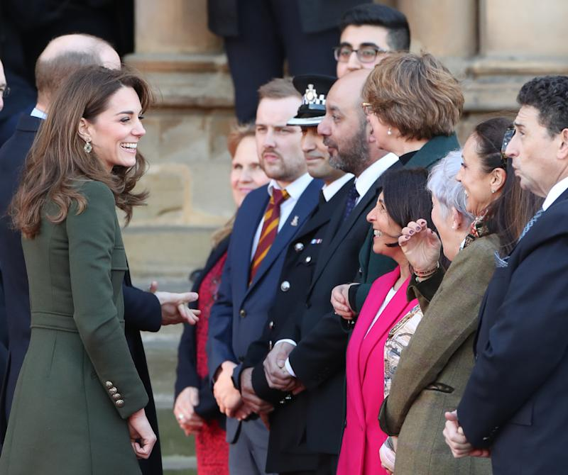 The Duke (hidden) and Duchess of Cambridge arrive for a visit to City Hall in Bradford to join a group of young people from across the community to hear about life in the city. [Photo: PA]