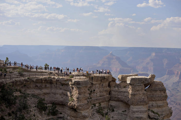 Image: Visitors stand on an observation deck at Mather Point of Grand Canyon National Park in Grand Canyon, Arizona. (Daniel Acker / Bloomberg via Getty Images file)