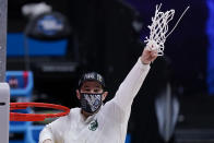 Baylor head coach Scott Drew holds up net after beating Arkansas during an Elite 8 game in the NCAA men's college basketball tournament at Lucas Oil Stadium, Tuesday, March 30, 2021, in Indianapolis. Baylor won 81-72. (AP Photo/Darron Cummings)
