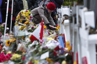 FILE - In this Saturday, Nov. 3, 2018 file photo, people place stones near the memorials outside the Tree of Life Synagogue after a service in Pittsburgh. Eleven people were killed and six others injured in a shooting during services there a week earlier. (AP Photo/Keith Srakocic)