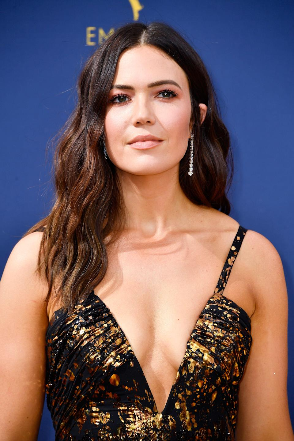 <p>Cool-toned makeup is having a moment, but Mandy Moore's sunset eyeshadow is proof you can't go wrong with warm, golden eyelids.</p>