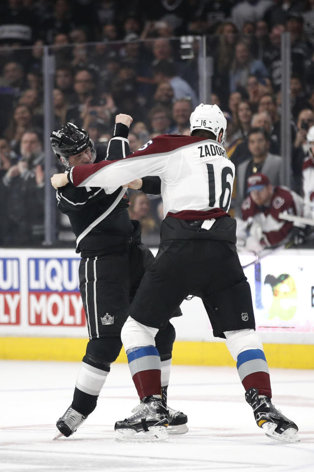 Los Angeles Kings' Dion Phaneuf, left, fights with Colorado Avalanche's Nikita Zadorov, of Russia, during the first period of an NHL hockey game Monday, April 2, 2018, in Los Angeles. (AP Photo/Jae C. Hong)