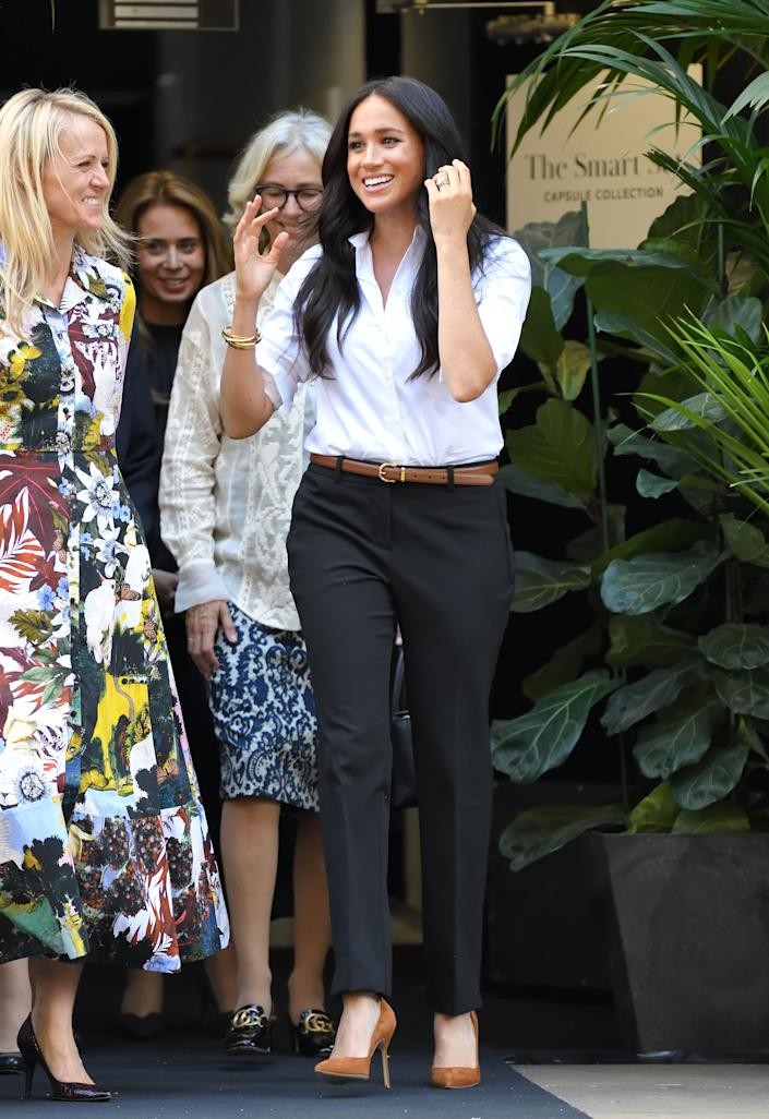 Meghan departs after attending the launch of the Smart Works capsule collection in London.