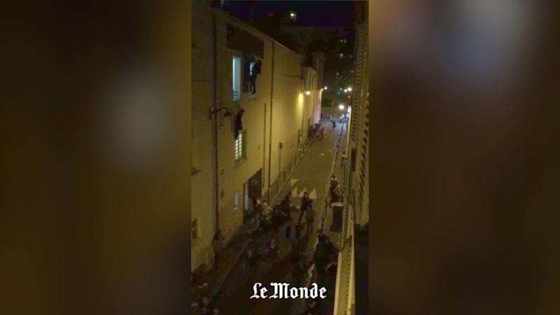 A still image made from a smartphone video by Le Monde journalist Daniel Psenny shows spectators fleeing from the back door and windows of the Bataclan concert hall on November 13, 2015 during a terrorist attack that left at least 129 people dead (AFP Photo/Daniel Psenny)