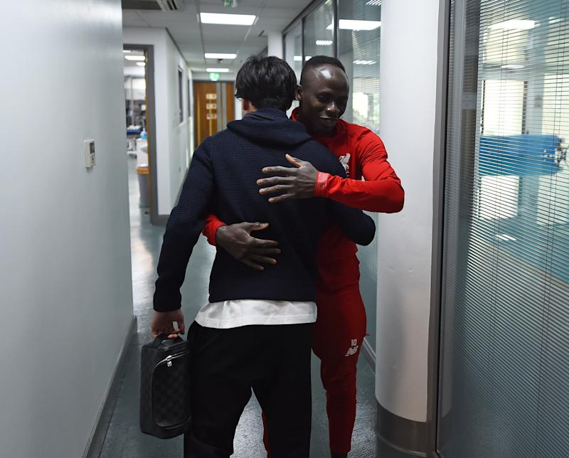 LIVERPOOL, ENGLAND - DECEMBER 31: (THE SUN OUT, THE SUN ON SUNDAY OUT) Takumi Minamino new signing of Liverpool on his first day with Sadio Mane of Liverpool at Melwood Training Ground on December 31, 2019 in Liverpool, England. (Photo by Andrew Powell/Liverpool FC via Getty Images)