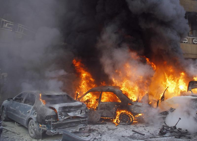 Cars burn following an explosion in the Haret Hreik area in the southern suburbs of Beirut
