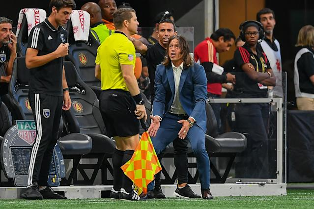 San Jose Earthquakes coach Matias Almeyda (blue suit) doesn't seem to be a fan of MLS officiating. (Rich von Biberstein/Getty)