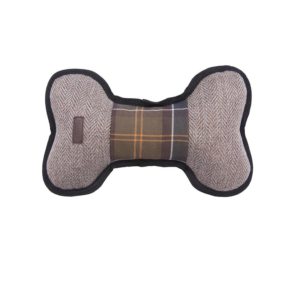 """<p>Give your dog a bone this Christmas in the form of a durable herringbone and tartan toy from Barbour. </p><p>£14.95, <a href=""""https://www.barbour.com/uk/catalog/product/view/id/63146/s/barbour-dog-toy/"""" rel=""""nofollow noopener"""" target=""""_blank"""" data-ylk=""""slk:Barbour"""" class=""""link rapid-noclick-resp"""">Barbour</a>.</p>"""