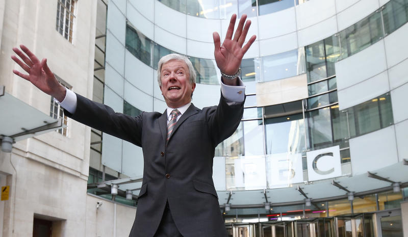 Tony Hall poses for photographers on his arrival at Broadcasting House for his first day as the new Director General of the BBC, in central London April 2, 2013. REUTERS/Andrew Winning (BRITAIN - Tags: ENTERTAINMENT MEDIA SOCIETY)