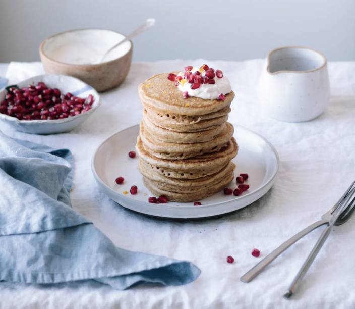 """<p>Pomegranate seeds are tart and refreshing. They're excellent on pancakes with a bit of cream! </p><p><strong>Get the recipe from <a href=""""https://warmandrosy.com/cardamom-spiced-spelt-almond-flour-pancakes-orange-vanilla-bean-yogurt-pomegranate-seeds/"""" rel=""""nofollow noopener"""" target=""""_blank"""" data-ylk=""""slk:Warm & Rosy"""" class=""""link rapid-noclick-resp"""">Warm & Rosy</a>. </strong></p><p><strong><a class=""""link rapid-noclick-resp"""" href=""""https://www.amazon.com/Shallow-Bowl/s?k=Shallow+Bowl&tag=syn-yahoo-20&ascsubtag=%5Bartid%7C2164.g.36146701%5Bsrc%7Cyahoo-us"""" rel=""""nofollow noopener"""" target=""""_blank"""" data-ylk=""""slk:SHOP SHALLOW BOWLS"""">SHOP SHALLOW BOWLS</a><br></strong></p>"""