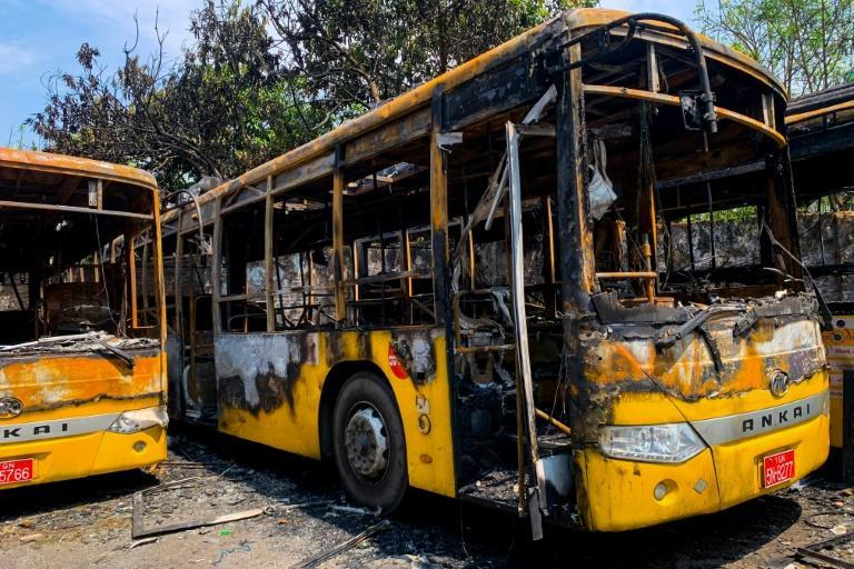 In Yangon, a number of city transport buses were torched overnight
