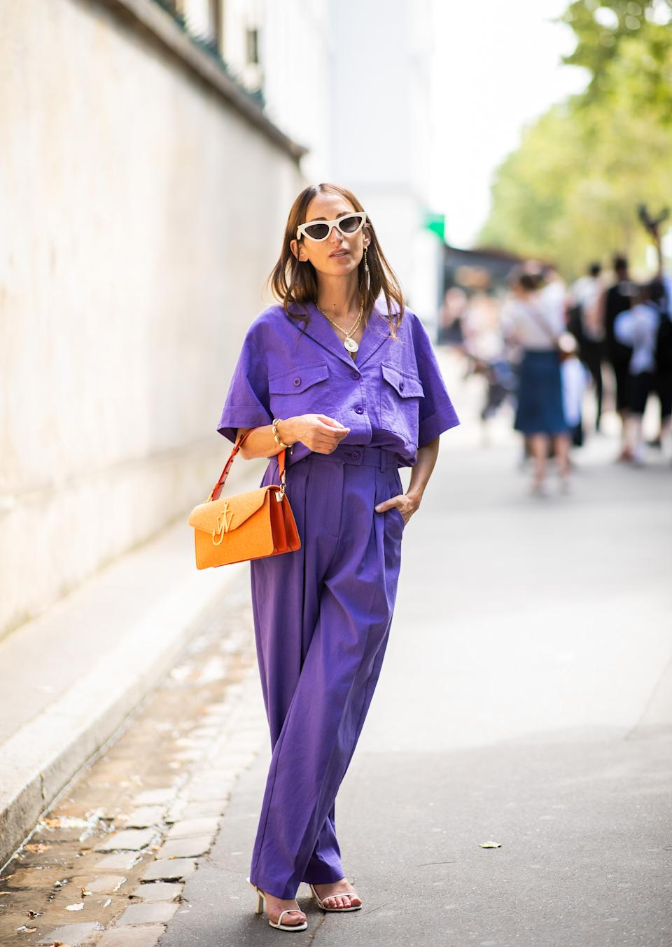 PARIS, FRANCE - JULY 02: A guest wearing purple pants and button shirt seen outside Dior on day two during Paris Fashion Week Haute Couture FW18 on July 2, 2018 in Paris, France. (Photo by Christian Vierig/Getty Images)