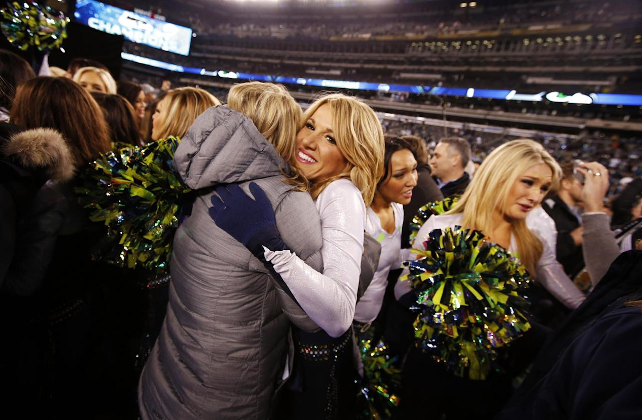 Seattle Seahawks cheerleaders celebrate on the field after the NFL Super Bowl XLVIII football game against the Denver Broncos, Sunday, Feb. 2, 2014, in East Rutherford, N.J. The Seahawks won 43-8. (AP Photo/Evan Vucci)