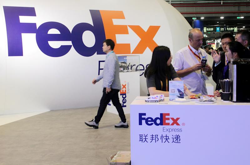 People visit a FedEx Express booth during the China International Import Expo (CIIE) at the National Exhibition and Convention Center in Shanghai, China November 7, 2018. Picture taken November 7, 2018. REUTERS/Stringer ATTENTION EDITORS - THIS IMAGE WAS PROVIDED BY A THIRD PARTY. CHINA OUT.