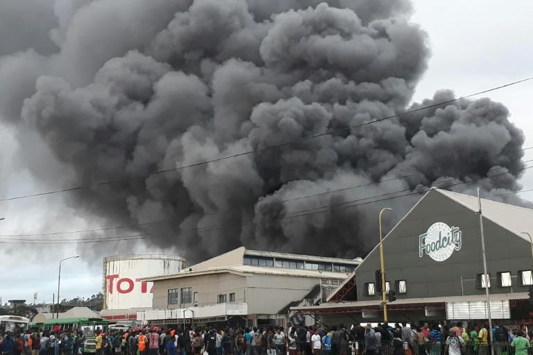 Thick smoke from a huge fire at one of Suva's largest markets blanketed the capital of Fiji (AFP Photo/Handout)