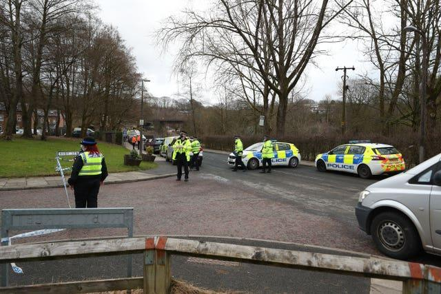 Officers patrol a police cordon in Ramsbottom, Bury, Greater Manchester, where the body of a woman has been found after a house collapsed on Wednesday evening