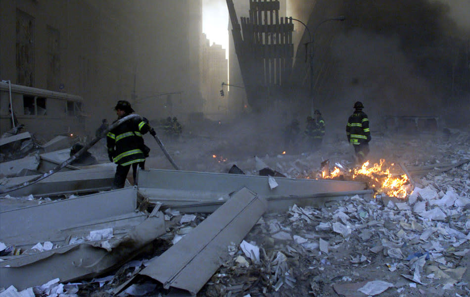 File picture shows firemen working around the World Trade Center after both towers collapsed in New York