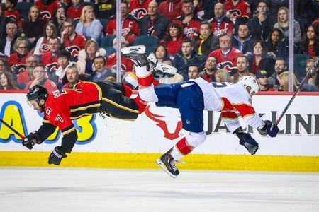 Jan 11, 2019; Calgary, Alberta, CAN; Calgary Flames defenseman TJ Brodie (7) and Florida Panthers center Micheal Haley (18) collide during the second period at Scotiabank Saddledome. Mandatory Credit: Sergei Belski-USA TODAY Sports