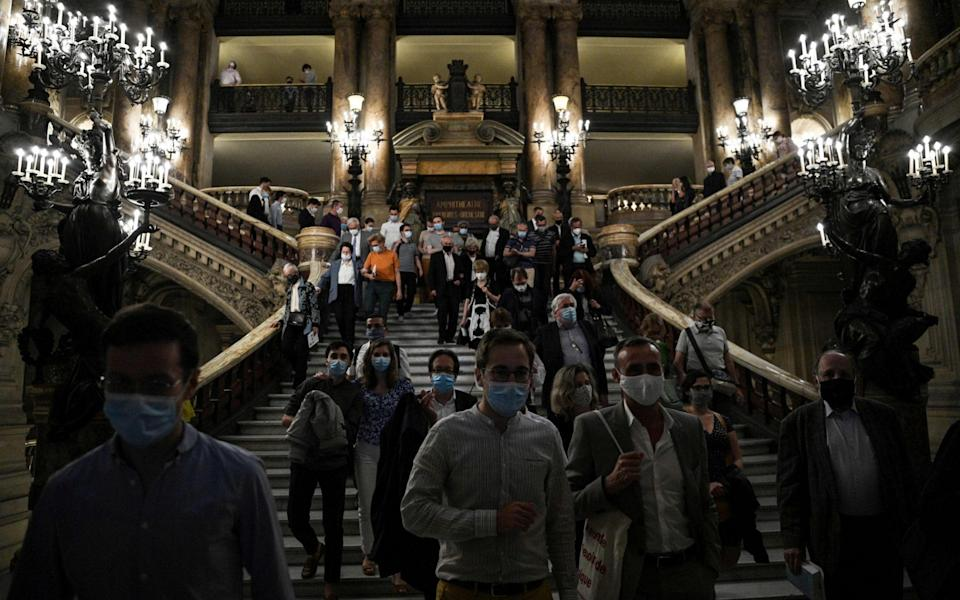 People leave after attending a concert given by the Opera de Paris for sponsors and healthcare workers involved in the fight against the Covid-19 disease caused by the novel coronavirus, at the Palais Carnier on July 13, 2020 in Paris - AFP/Anne-Christine Poujoulat