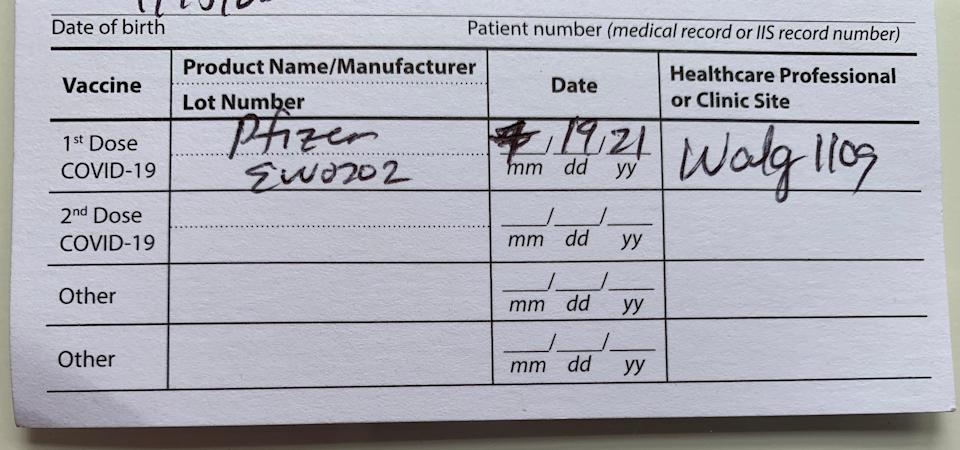 Close up of a CDC COVID-19 Vaccination Record Card, showing the two lines at the bottom that can be used to document booster doses, should they become available.