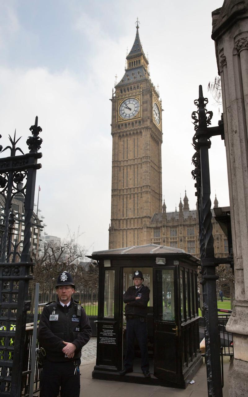 Police guarding the Carriage Gates at the House of Parliament after the terror attack   - Credit: Heathcliff O'Malley