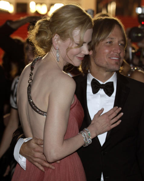 Actress Nicole Kidman, left, and musician Keith Urban depart following the screening of The Paperboy at the 65th international film festival, in Cannes, southern France, Thursday, May 24, 2012. (AP Photo/Lionel Cironneau)
