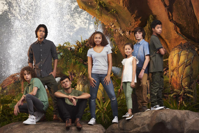 """New <i>Avatar</i> cast pose at Pandora:€"""" The World of Avatar attraction in Disney's Animal Kingdom theme park. L-R: Britain Dalton (Lo'ak of the Sully Family), Filip Geljo (Aonung of the Metkayina Clan), Jamie Flatters (Neteyam of the Sully Family), Bailey Bass (Tsireya of the Metkayina Clan), Trinity Bliss (Tuktirey of the Sully Family), Jack Champion (Javier 'Spider' Socorro), and Duane Evans Jr (Rotxo of the Metkayina Clan).(Photo Credit: Sheryl Nields/20th Century Fox)"""
