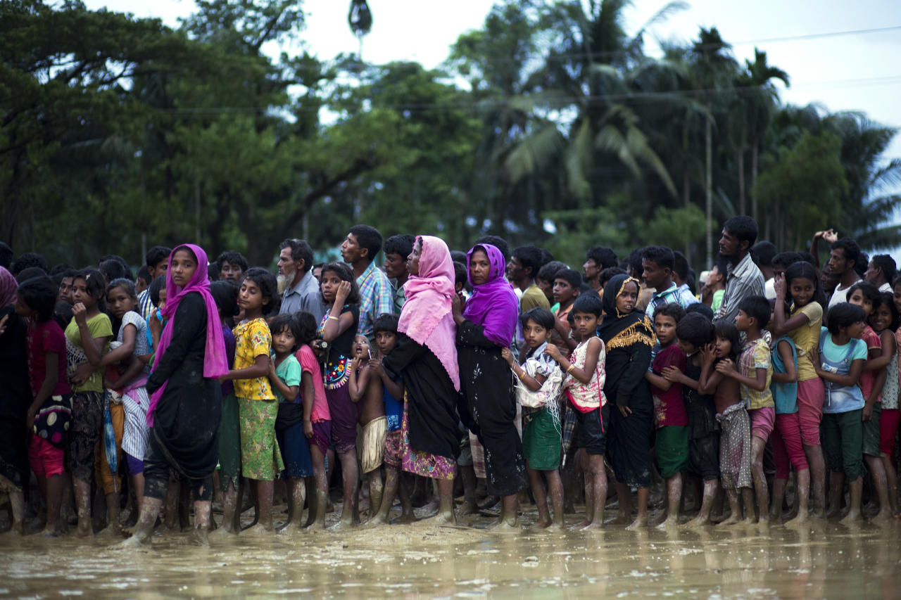 <p> Rohingya Muslims, who crossed over recently from Myanmar into Bangladesh, stand in a queue to receive food being distributed near Balukhali refugee camp in Cox's Bazar, Bangladesh, Tuesday, Sept. 19, 2017. More than 500,000 Rohingya Muslims have fled to neighboring Bangladesh in the past year, most of them in the last three weeks, after security forces and allied mobs retaliated to a series of attacks by Muslim militants last month by burning down thousands of Rohingya homes in the predominantly Buddhist nation. (AP Photo/Bernat Armangue) </p>
