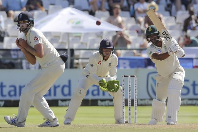 Vernon Philander plays a shot as Jos Buttler looks on (AP)