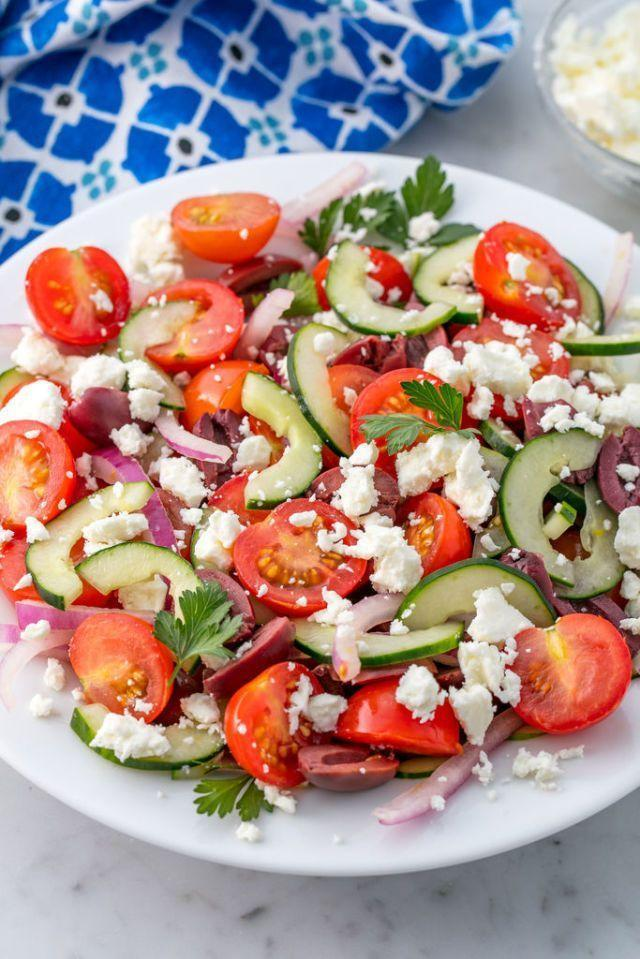 """<p>Known as horiatiki, this traditional <a href=""""https://www.delish.com/uk/food-news/a30624859/greek-food/"""" rel=""""nofollow noopener"""" target=""""_blank"""" data-ylk=""""slk:Greek"""" class=""""link rapid-noclick-resp"""">Greek </a>salad is made with cherry tomatoes, cucumber, kalamata olives, thinly sliced red onion, and feta. The easy dressing is a mixture of red wine vinegar, fresh lemon juice, dried oregano, and extra-virgin olive oil. </p><p>Get the <a href=""""https://www.delish.com/uk/cooking/recipes/a28839760/best-greek-salad-recipe/"""" rel=""""nofollow noopener"""" target=""""_blank"""" data-ylk=""""slk:Greek Salad"""" class=""""link rapid-noclick-resp"""">Greek Salad</a> recipe. </p>"""