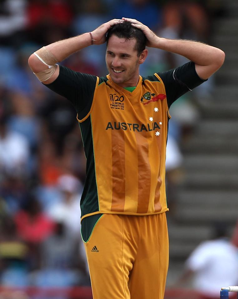 GROS ISLET, SAINT LUCIA - MAY 14: Shaun Tait of Australia looks despondent as runs are scored of his bowling during the semi final of the ICC World Twenty20  between Australia and Pakistan at the Beausejour Cricket Ground on May 14, 2010 in Gros Islet, Saint Lucia.  (Photo by Julian Herbert/Getty Images)