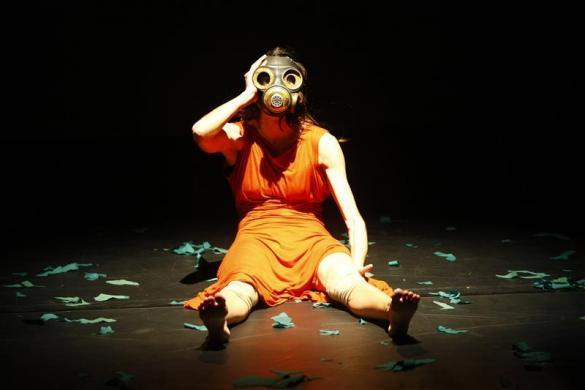 """Greek choreographer and performer Athanasia Kanellopoulou wears a mask as she takes part in the dress rehearsal of her solo dance theatre performance """"Penelope: Dust in our Awakened Dreams"""" at the Mediterranean Institute Theatre Programme theatre in Valletta, March 1, 2012."""