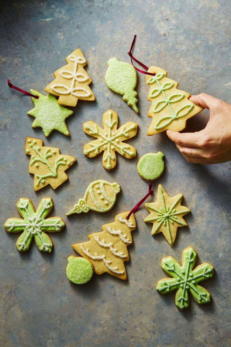 """<p>The best part of baking up a batch of """"ornament cookies"""" is forgetting they're for the tree—oh, and nibbling on a few. (We won't tell!)</p><p><strong>Get the tutorial at <a href=""""https://www.goodhousekeeping.com/food-recipes/dessert/a46925/sugar-cookie-ornaments-recipe/"""" rel=""""nofollow noopener"""" target=""""_blank"""" data-ylk=""""slk:Good Housekeeping"""" class=""""link rapid-noclick-resp"""">Good Housekeeping</a>. </strong></p><p><a class=""""link rapid-noclick-resp"""" href=""""https://www.amazon.com/slp/red-ribbons/6yz5jcy7bja2735?tag=syn-yahoo-20&ascsubtag=%5Bartid%7C10050.g.1070%5Bsrc%7Cyahoo-us"""" rel=""""nofollow noopener"""" target=""""_blank"""" data-ylk=""""slk:SHOP RED RIBBON"""">SHOP RED RIBBON</a></p>"""