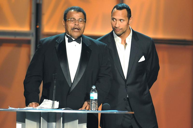 "Actor Dwayne ""The Rock"" Johnson, right, with his father, Rocky Johnson, at the WWE Hall of Fame induction in 2008 in Orlando, Florida. (Photo: George Napolitano/MediaPunch/IPx)"